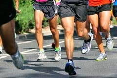 Marathon Racers. Group of marathon racers running Royalty Free Stock Images