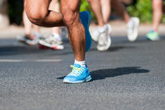 Marathon Racers. Group of marathon racers running on a street Royalty Free Stock Image