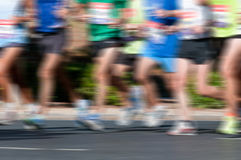 Marathon Racers. Group of marathon racers running with heavy motion blur applied Stock Image