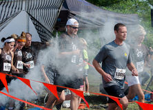Marathon racers start running. Marathon racers pass through the starting line, during the July 2014 mudathlon in northwest Indiana Stock Photography