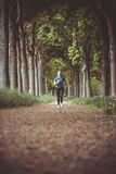 Marathon run in the autumn forest Royalty Free Stock Image