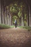 Marathon run in the autumn forest Royalty Free Stock Image