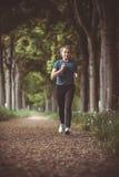 Marathon run in the autumn forest Stock Photos