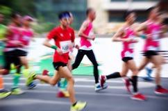 A marathon run on a city road Stock Photos