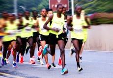 A marathon run on a city road Stock Images