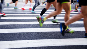 A marathon run on a city road Royalty Free Stock Image