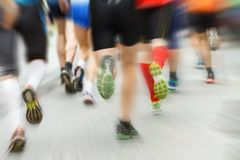 Marathon run. Legs with zoom burst effect. Marathon run with dynamic zoom burst effect. Pro and amateur runners together stock photography