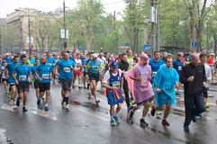 Marathon run in the rain Royalty Free Stock Images