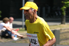 Marathon runner. Senior marathon runner on his way to the finish stock photos