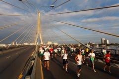 Marathon runner on  bridge Stock Photo