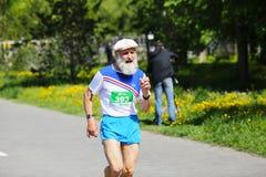 Marathon runner compete at the Spring Half Marathon Stock Photos