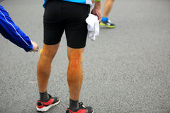 Marathon runner got legs injuried Stock Photography
