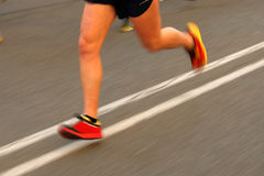 Marathon runner legs. On the road with panning blur Royalty Free Stock Photo