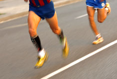 Marathon runner legs Royalty Free Stock Image