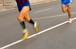 Marathon runner legs Stock Images