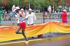 Marathon runner at marathon aid station royalty free stock photo