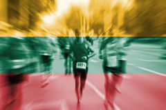 Marathon runner motion blur with blending Lithuania flag stock images