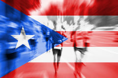 Marathon runner motion blur with blending  Puerto Rico flag Royalty Free Stock Photo