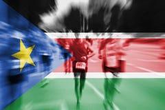 Marathon runner motion blur with blending  South Sudan flag Stock Image