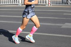 Runner running on city road. Marathon runner running on city road Royalty Free Stock Images