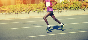 Marathon runner running on city road. Male marathon runner running on city road Stock Image