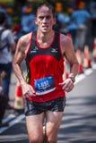 Marathon Runner. Running to the finishing stock photos