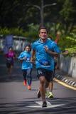 Marathon Runner. Running to the finishing stock photo
