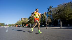 Marathon runner ultra wide angle side view Royalty Free Stock Photo