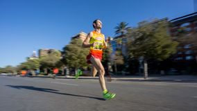Marathon runner ultra wide angle side view Royalty Free Stock Photography