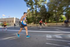 Marathon runner ultra wide angle side view stock photo