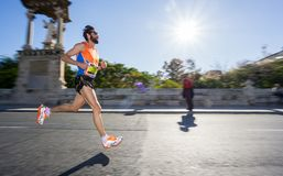 Marathon runner ultra wide angle side view Royalty Free Stock Photos