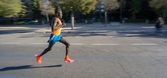 Marathon runner ultra wide angle side view stock photography