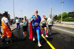 Marathon runner wearing a superman costume Royalty Free Stock Images
