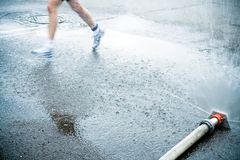Marathon runner on wet city street Stock Photo