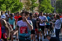 Riga, Latvia - May 19 2019: Marathon runner young man drinking water royalty free stock images