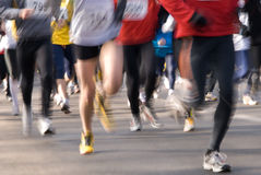 Marathon runners. Group of people running in a marathon stock photos