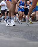 Marathon runners. Group of people running marathon race Stock Photos