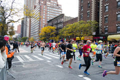 Marathon runners along first avenue in the NYC marathon 2016 Royalty Free Stock Image