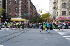 Marathon runners along first avenue in the NYC marathon 2016 Royalty Free Stock Images