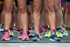 Marathon runners. Athletes waiting at marathon start line stock photo