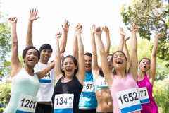 Marathon runners cheering in park Royalty Free Stock Photo