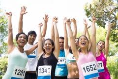 Marathon runners cheering in park Royalty Free Stock Photo