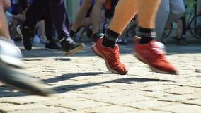 Closeup marathon runners legs stock footage