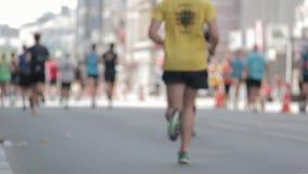 Marathon Runners Crowd Bottom View Legs Out Off Focuss. Marathon Runners Crowd Bottom View Legs. Athletes Runing Out Off Focuss. Blurred Runner Feet Running stock video