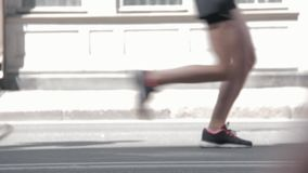 Marathon Runners Crowd Side View Legs Out Off Focuss. Marathon Runners Crowd Side View Legs. Athletes Runing Out Off Focuss. Blurred Runner Feet Running stock footage