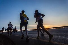 Marathon Runners Dawn Sunrise Contrasts Stock Image