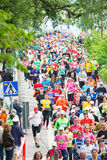 Marathon runners decending from the famous Vasterbron bridge Royalty Free Stock Photography
