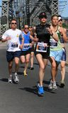 Marathon Runners Exiting Bridge Royalty Free Stock Photography