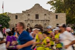 Marathon Runners in Front of the Alamo royalty free stock photos