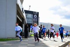 Marathon runners Kids' Cross Royalty Free Stock Images